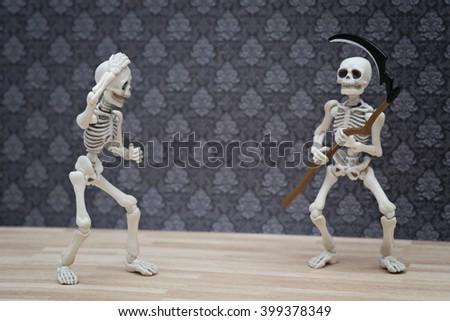 skeletons and the scythe - stock photo
