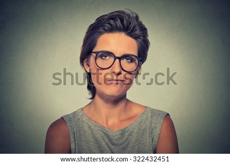 Skeptic. Doubtful upset angry woman in glasses looking at you camera isolated on gray wall background. Negative human emotion facial expression feeling body language attitude - stock photo