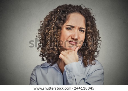Skeptic. Doubtful woman looking at you camera isolated grey wall background. Negative human emotion facial expression feeling body language attitude - stock photo