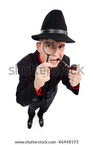 Skeptical detective with pipe in his mouth looking up through magnifying glass - stock photo