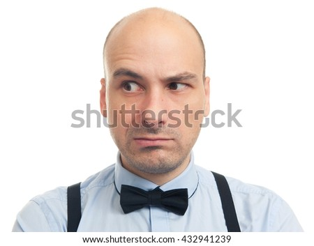 skeptical serious bald man looking away. Isolated - stock photo