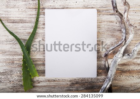 Sketch book and herbs on wooden background - stock photo