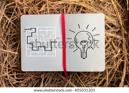 sketch book with maze and bulb drawing Creativity idea concept - stock photo