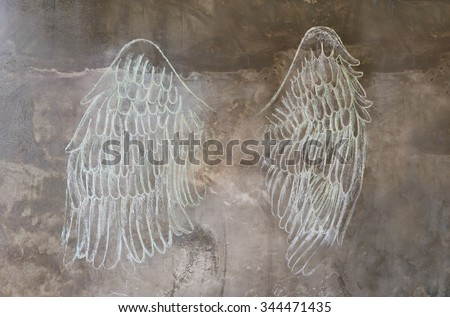 sketch chalk angle wing on wall - stock photo