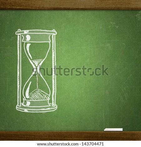 sketch hourglasses on school blackboard - stock photo