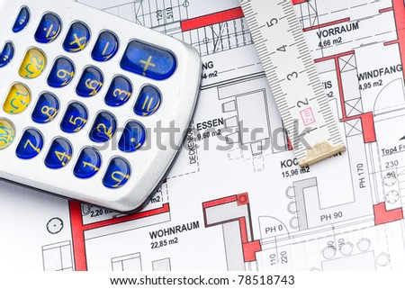 sketch of a houseplan with a calculator and a ruler - stock photo