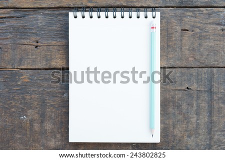 sketchbook on  wood table for background and text - stock photo
