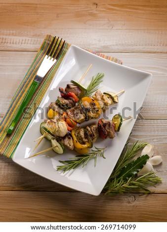 skewer with meat zucchinis and capsicum - stock photo