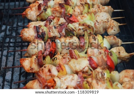 Skewers of chicken and vegetables in a bbq in Praga - stock photo
