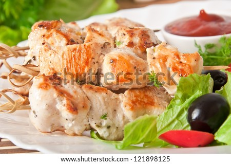 skewers of chicken with salad - stock photo