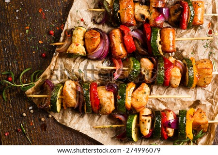 Skewers of grilled meat and vegetables - stock photo