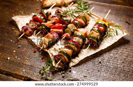 Skewers of grilled vegetables and meat - stock photo