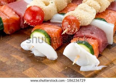 skewers of raw fish - stock photo