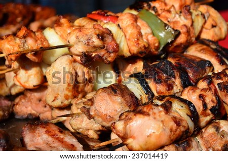 Skewers on wooden sticks tasty pork meat and vegetables mix - stock photo