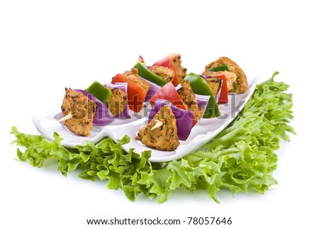 Skewers with chicken and vegetables on the plate - isolated - stock photo
