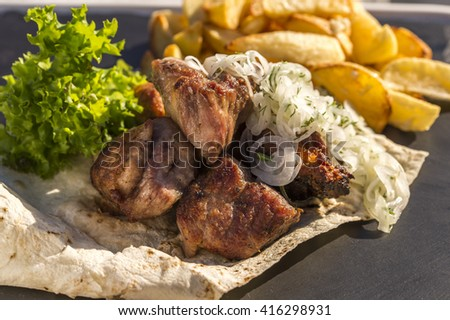 skewers with potatoes and onions on a plate