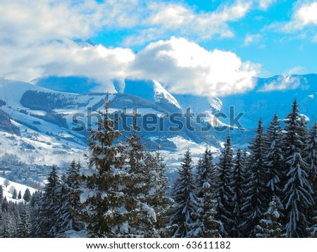 Ski area mountain landscape with Mont Blanc in distance . Combloux French alps France - stock photo
