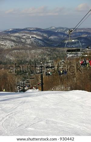 Ski Chair-Lift with Mountainous Background - stock photo