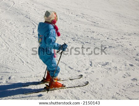 Ski Girl sliding dawn the slope