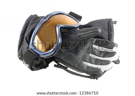 Ski goggles and winter gloves on white background