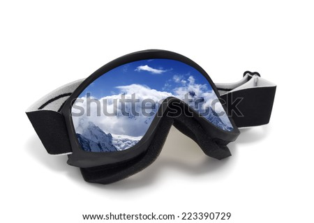 Ski goggles with reflection of snowy mountains. Isolated on white background - stock photo