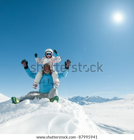 Ski holiday - Skiers playing in snow (copy space) - stock photo