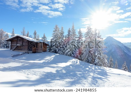 Ski hut in the forest at sunrise - stock photo