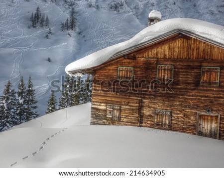 Ski hut in the snow HDR - stock photo