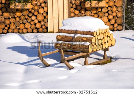 ski hut in winter with sledge and snow - stock photo