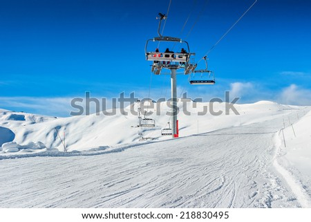 Ski lift and ski course in the mountains,Les Sybelles,France,Europe - stock photo