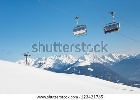Ski Lift at Ski Resort in the Alps, South Tyrol, Italy. - stock photo