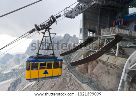 Ski lift cabin arriving to the upper station on Dachstein mountain, Austria