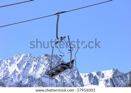 Ski lift chair on snow covered mountain in a ski resort