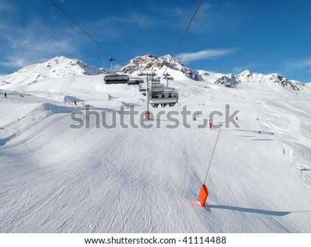 Ski lift chairs in Alpes, Switzerland. - stock photo