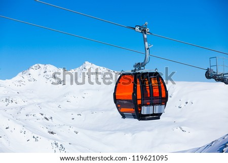 Ski lift chairs on bright winter day - stock photo