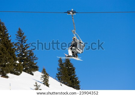 Ski lift going up the track