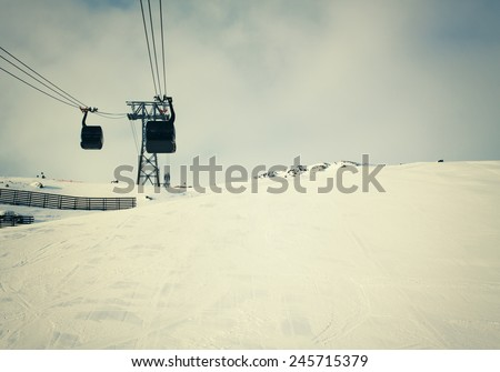 Ski lift in alps mountains, winter season - stock photo