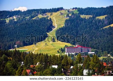 Ski lift in the background near Zakopane, Poland - stock photo