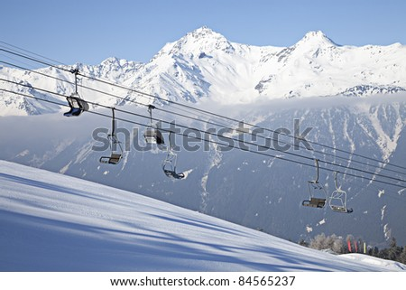 Ski lift on mountains background. Bormio, Italy - stock photo