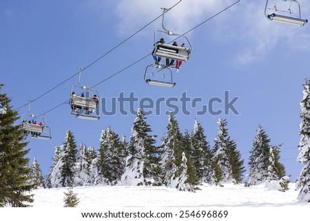 Ski lift on the mountain - stock photo