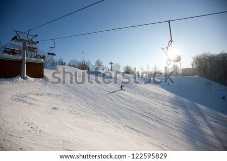 Ski lift over snowy mountain, Sigulda, Latvia, Baltic States, Europe - stock photo