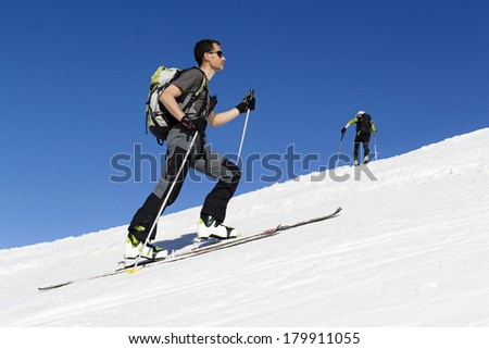 Ski mountaineering cross country skiing in Italian Alps - stock photo