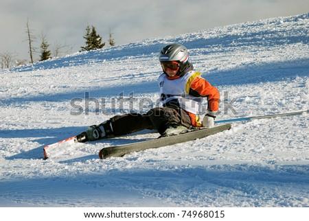 ski race - little boy fallen - stock photo
