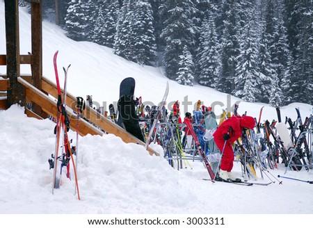 Ski rack near a chalet at downhill ski resort - stock photo