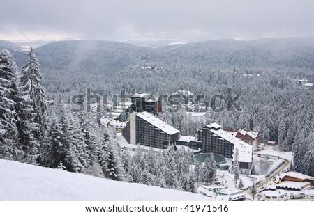 Ski resort Borovets, Bulgaria. Hotel complex and panorama of winter mountains - stock photo