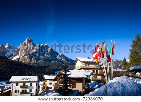 Ski Resort In Italian Alps. Flags Against Winter Landscape.
