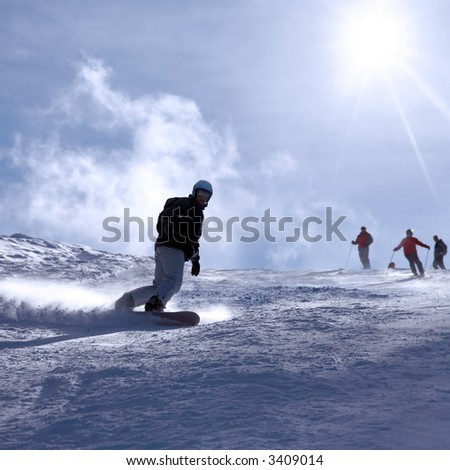 Ski resort Italy , man snowboarding - stock photo