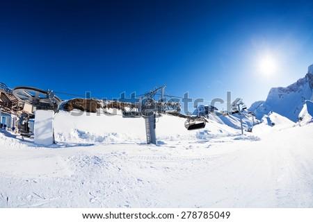 Ski resort panorama with piste and skilift ropeway - stock photo