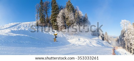 ski resort snow guns running in the snow and trees  winter holiday in the mountains of skiing and snowboarding - stock photo