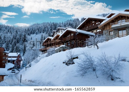 Ski resort with winter chalets - France - stock photo